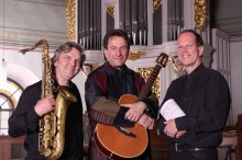 Konzert mit Clemens Bittlinger in der Nathanaelkirche   mit Saxophon, Gitarre, Orgel & Gesang